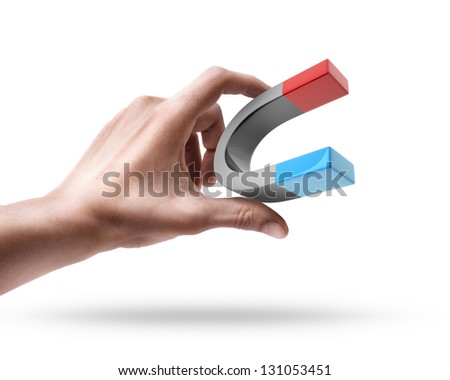 Man's hand holding magnet isolated on white background - stock photo