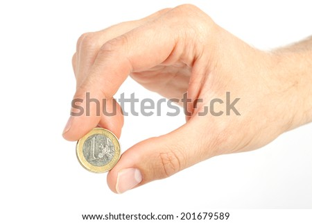 Man's hand holding One euro coin on white background  - stock photo