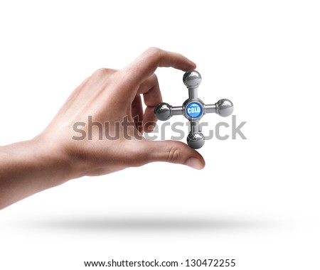 Man's hand holding Shining chrome faucet isolated on white background - stock photo