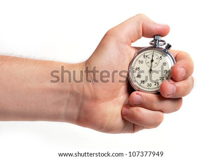 Man's hand holding stopwatch, isolated on the white background - stock photo