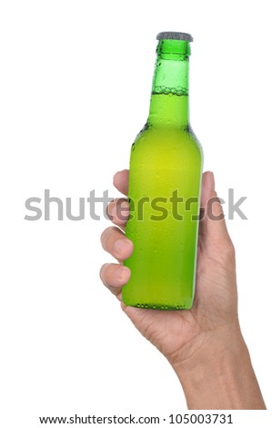 Man's hand holding up a green beer bottle without label over a white background vertical format - stock photo
