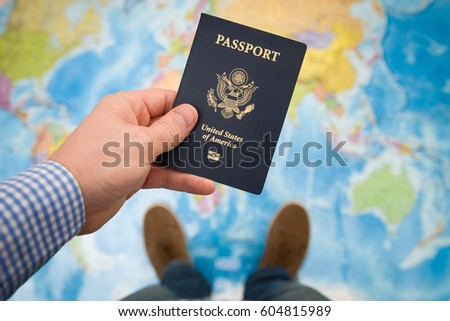 Man S Hand Holding Us Passport Map Background Ready For Traveling Open World