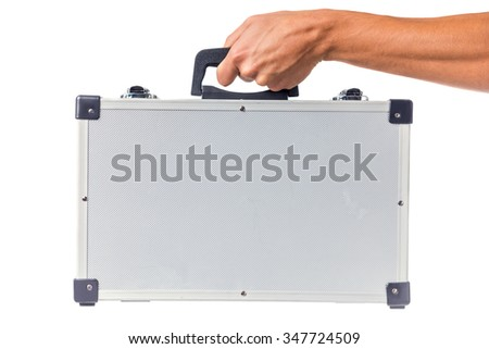 Man's hand holds a suitcase isolated on a white background - stock photo