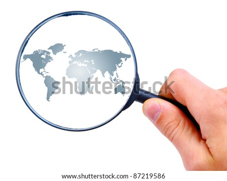 man's hand is searching with magnifying glass - stock photo