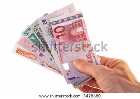 Man's hand offering a range of currencies - stock photo