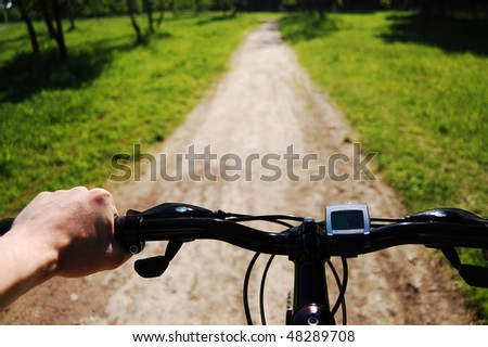 Man's hand on a bike handle bar: ready to start - stock photo