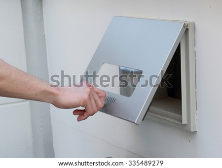 man's hand open the post box