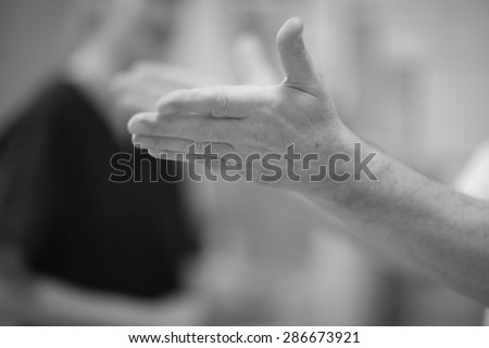 Man's hand outstretched, inspiring gesture - stock photo