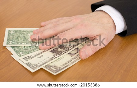 Man's hand over a pack of dollars