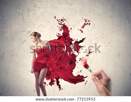 Man's hand painting the elegant dress of a beautiful woman - stock photo