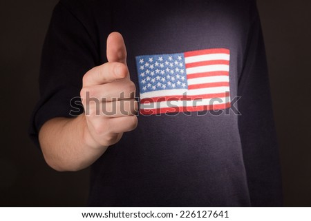 man's hand pointing at you with american flag - stock photo