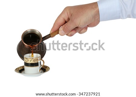 Man's hand pours coffee in a cup of coffee pots. Isolation on a white background. Clipping path. - stock photo