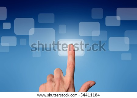 Man's hand pressing a button on a touchscreen - stock photo