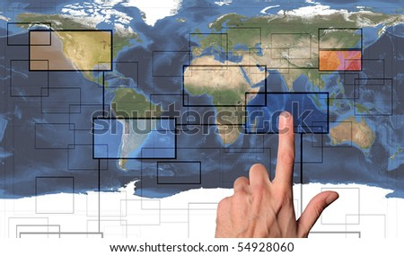 Man's hand pressing a button on a world man - stock photo