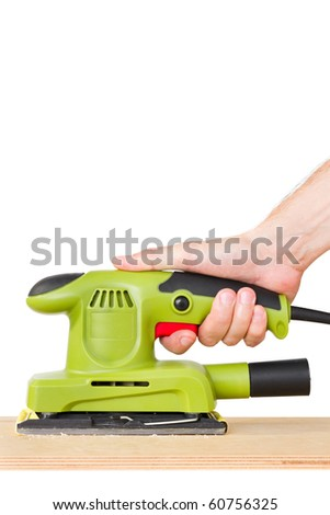 man's hand sanding plank with electric sander - stock photo