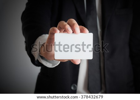 Man's hand showing blank  business card - stock photo