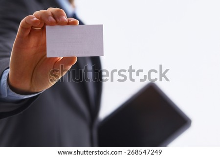 Man's hand showing business card  - stock photo