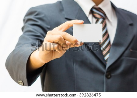 Man's hand showing business card - closeup shot on white background - stock photo