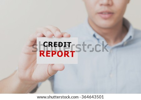 Man's hand showing CREDIT REPORT text on the card business card - closeup shot on white background. - stock photo