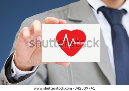Man's hand showing Heart pulse card.