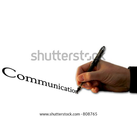 Man's hand with a pen writing and/or signing, with the word Communication - isolated over white background. - stock photo