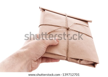 Man's hand with envelope tied with a rope isolated on white - stock photo