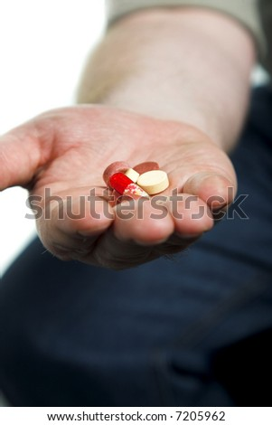 man's hand with lot of different drug