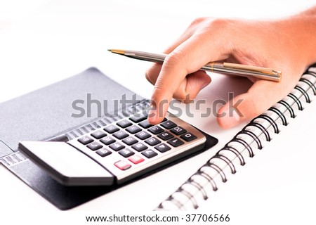 Man's hand with pen calculating on a white background - stock photo