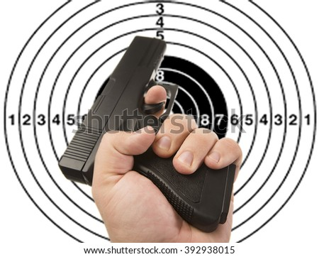 man's Hand with pistol isolated on white background - stock photo