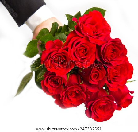 man's hand with red roses bouquet - stock photo