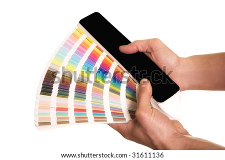 man's hands holding a color guide pantone - stock photo
