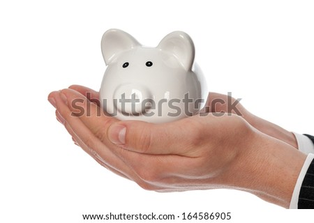 Man's hands holding white piggy bank isolated on white. - stock photo