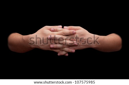 man's hands on a black background