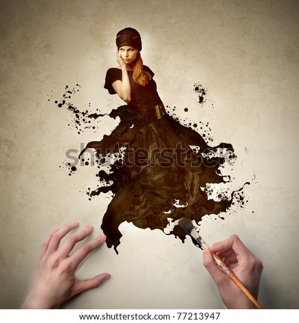 Man's hands painting the elegant dress of a beautiful woman - stock photo