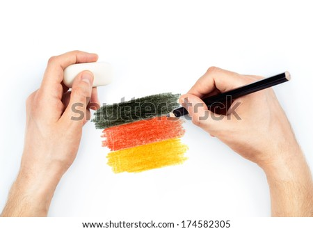 Man's hands with pencil draws flag of Germany on white background - stock photo