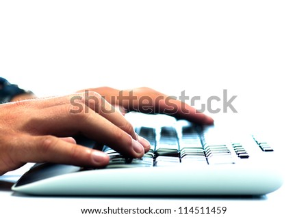 Man's hands working on computer keyboard against white background - stock photo