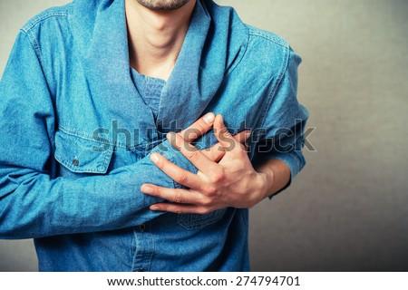 man's heart aches - stock photo