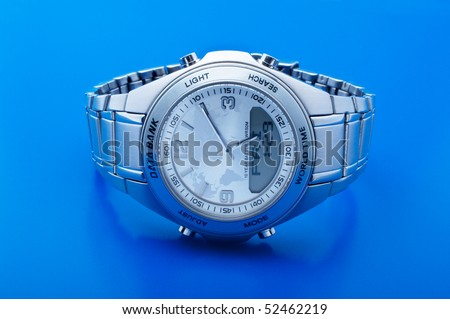 Man's hours with a bracelet on a  blue background - stock photo