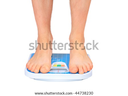 Man's legs , which  weighed on floor scale. Isolated over white. - stock photo