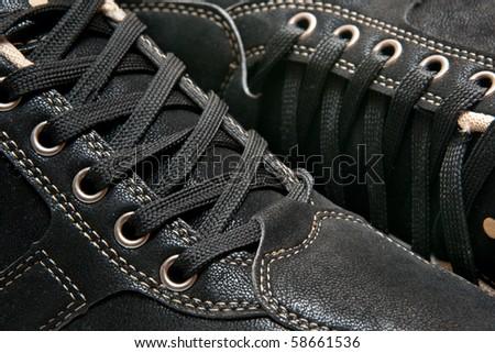 man's new black shoes, closeup - stock photo