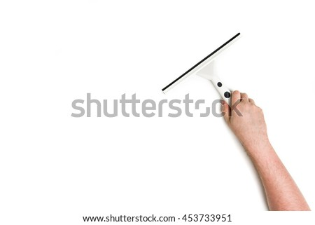 Man's or woman's hand cleaning with a squeegee on white background. - stock photo