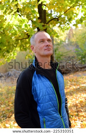 Man's portrait in autumn park - stock photo