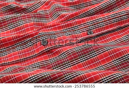 Man's red cotton plaid shirt detail - stock photo