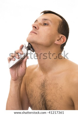 man's shaving electric razor - stock photo