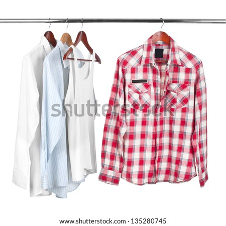 Man's shirts and  white t-shirt  on wooden hanger - stock photo