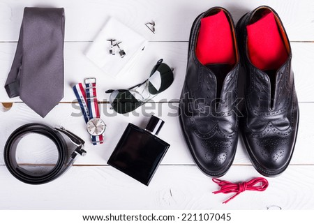 Man's style, urban shoes, socks and accessories on wooden table - stock photo