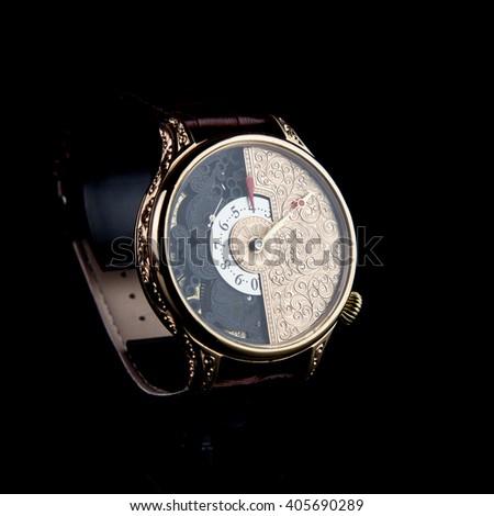Man's watch on black background. Luxury goods - stock photo