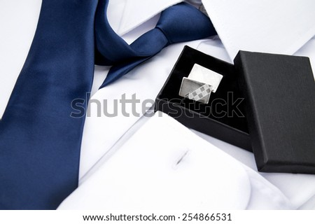 Man's white shirt with blue tie and cufflinks - stock photo