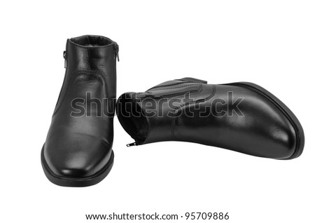 Man's winter boots of black colour on a white background