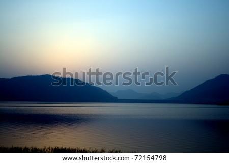 Man Sagar Lake, Jaipur. Man Sagar Lake, is a 300-acre lake, surrounded by the Nahargarh hills. - stock photo